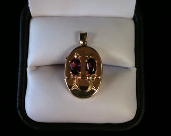 14k Yellow Gold Locket With Two Amethysts  2.8gms