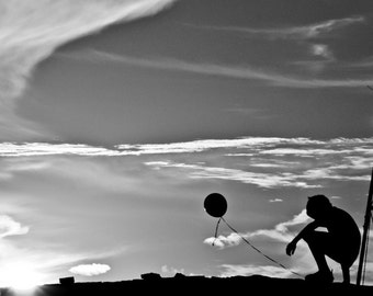 Dreaming Boy With Balloon in the Texas Sunset