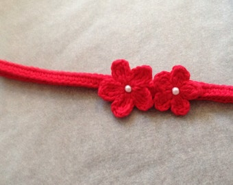 Pretty headband with two flowers on side