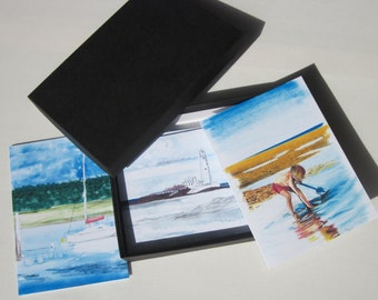 This is a boxed set of 12 notelets showing prints of our own original art work.