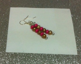 Clearance sale  Pretty pink and  gold dangle earrings.