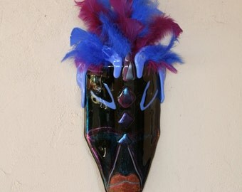 Glass mask with feathers