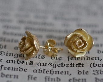 Earring pair of massive 750 / 18 ct gold roses