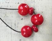 handmade lampwork glass beads red