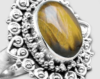 Sae: Tigereye and Sterling Silver Ring Size 8