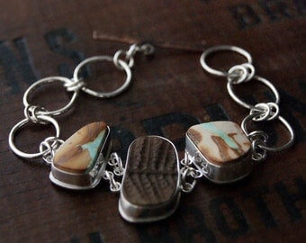 Parched, a Ribbon Turquoise and Fern Fossil linked Silver bracelet