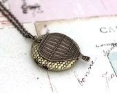 hot air balloon. locket necklace. brass ox jewelry weave locket