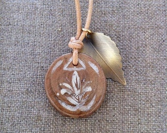 Faery Charm Casurina Pendant with hand painted detail and a golden metal leaf