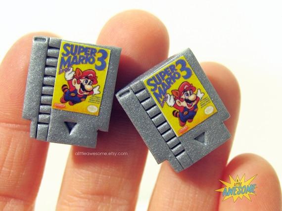 Super mario bros 3 boutons de manchettes bijoux de gamer nes for Portent of item protection