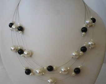 SALE Black and White Floating Infinity Pearls with complimentary Earrings