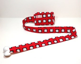 Red and black squares TuneTube.  Earbud cord organizer for iPhone or iPod.  Cord keeper.  Earbud holder.  Earbud case.