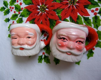 two charming miniature santa mugs