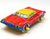 60s tin toy CAR, red with blue & yellow, from Japan.