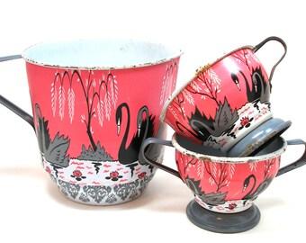 50s Tin Toy pitchers, Swan & Pagoda graphics on cream, sugar and tea pot.