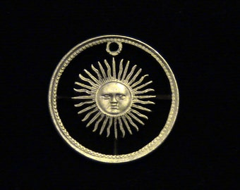 ARGENTINA - cut coin jewelry - Smiling Sun and Rays - 1977