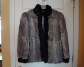 Reduced price....Beautiful, clean and soft Sergio Valente 2 toned rabbit fur jacket with muted pink silky lining- size Large