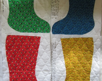Four Calico Christmas Calico Stockings To Stitch Up For Chriistmas In Red, Yellow, Blue, And Green Plus a Bonus