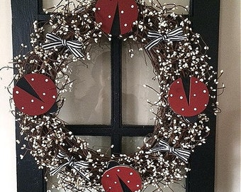 "18"" Ladybug wreath with pip berries"
