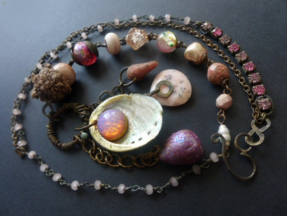 Abditive. Rustic assemblage necklace in shades of pink with vintage glass opal and seashell.
