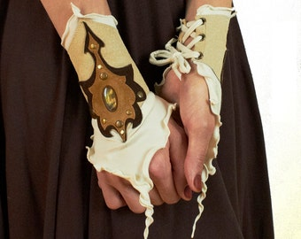 Wereneja - leather/jersey cuffs with leather art appliques, lace closure.