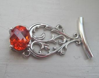 sterling silver filigree pendant with orange cz