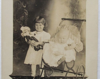 RPPC Real Photo POSTCARD of Little Girl with DOLL and Buggy