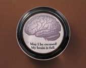 """Funny """"May I Be Excused"""" Brain Quotation Black and Brown Round Glass Paperweight"""