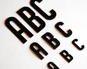 vintage black alphabet letters with gummed back, for scrapbooking or sign making