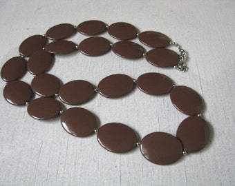 Long chocolate brown flat disc necklace with silver bead accents