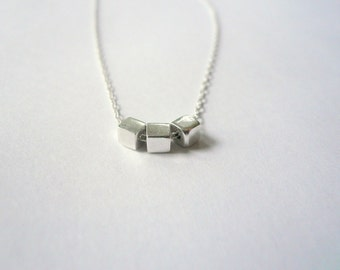 Sterling silver necklace. Tiny sterling cubes on drawn cable sterling chain. Miniature geometric necklace.