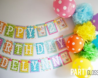 Sweet Shop Birthday Party Banner with Balloons and Tissue Poms Decorations Fully Assembled