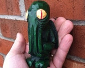 Cthulhu Idol, dark green w/eyes in red and cream