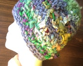 SHOP SALE. Women's warm, winter hat. Handspun freeform crochet. Blue and green with little spots of multicolor. Soft and stretchy.