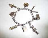 Vintage 1940s Sterling Silver Charm Bracelet on Etsy by Apurplepalm
