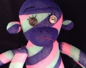 Unhappy striped Sock Monkey with button eyes