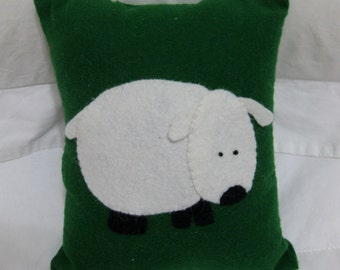 Sweet little hand sewn sheep on a green flannel pillow 8 x 6