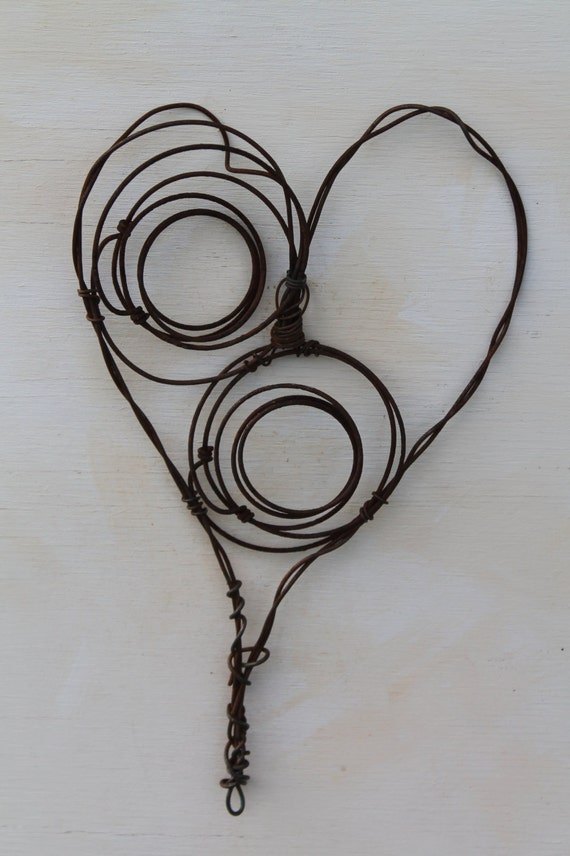 Used Baling Wire : Handmade wall heart made of baling wire and rusted chair