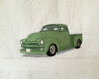 Classic green pickup truck, embroidered on white hand towel