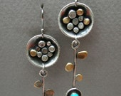 Dangling flower earrings: Long sterling silver and brass abstract flower earrings with leaves and 4 mm turquoise stone