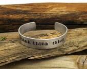 Think Think Think hand hammered, hand stamped half inch aluminum cuff bracelet