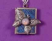 Butterfly Love Locket, blue and silver, holding 14 expressions of love from around the world