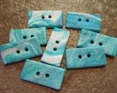 8 Blue and White Glitter Swirl Rectangular Polymer Buttons.