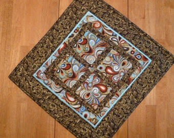 Groovy fabric quilt hand quilted wall hanging or table topper.