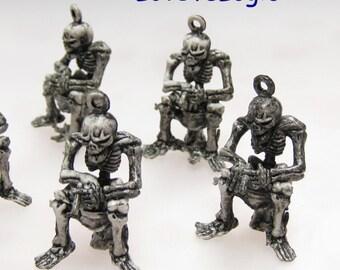 4 Meditate Skeleton Plastic Charms.