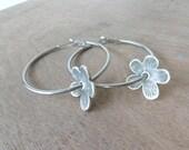 Silver flower hoop earrings