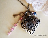 large Brass Filigree Heart Watch with beads key and a blue heart