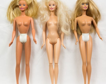 Three Barbie Dolls with Blonde Hair, All with blue eyes and opened mouths