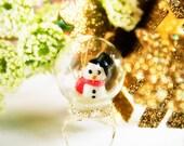 Snowman in a glass globe winter wonderland ring