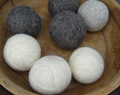 Four Felted Wool Dryer Balls in natural colors