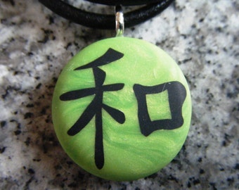 PEACE Japanese kanji symbol hand carved on a polymer clay green pearl color background. Pendant comes with a FREE 3mm necklace